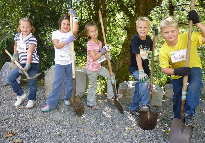 Group of young program participants with shovels