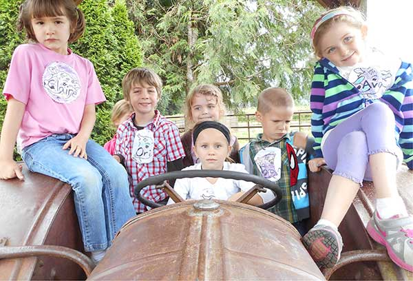 OMF, Inc. Students on the old tractor