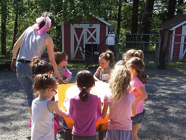 Stephanie Rickerts and Young Students With a Wheelbarrow
