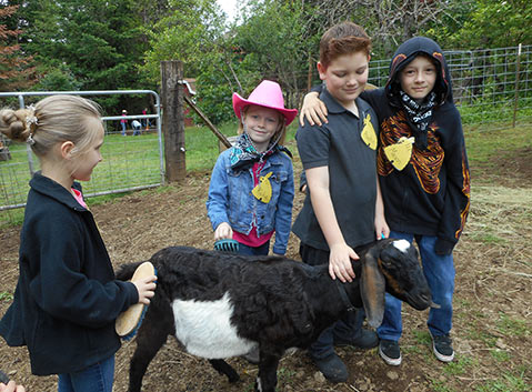 Children at OMF Summer Programs With Goats
